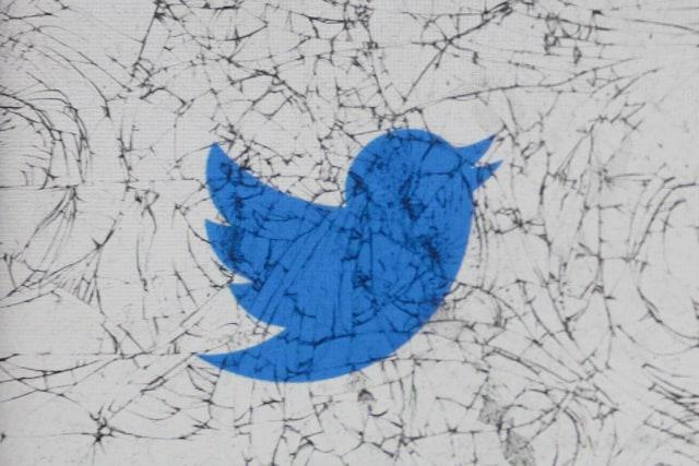 Twitter logo is seen through the broken glass in this illustration photo taken in Krakow, Poland on February 28, 2020. (Photo by Jakub Porzycki/NurPhoto via Getty Images)