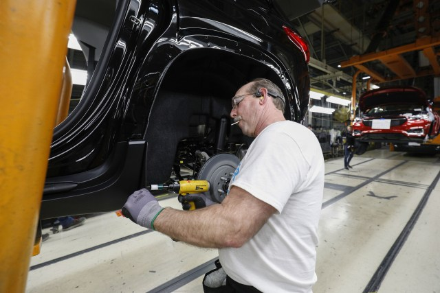 LANSING, MI - FEBRUARY 21: A General Motors worker is shown on the assembly line at the General Motors Lansing Delta Township Assembly Plant on February 21, 2020 in Lansing, Michigan. The plant, which employs over 2,500 workers, is home to the Chevrolet Traverse and Buick Enclave. Today at the plant the three millionth vehicle made at the plant, a Chevrolet Traverse Redline Edition rolled off the line. (Photo by Bill Pugliano/Getty Images)