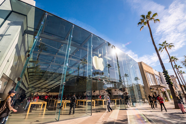 Santa Monica, USA - December 23, 2015: Apple Store on Third Street Promenade with people shopping inside and sightseeing outside on famous shopping street in Santa Monica downtown decorated for Xmas holidays.