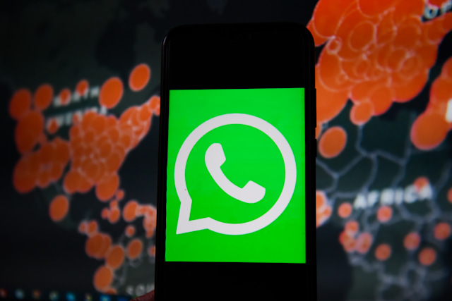 POLAND - 2020/03/19: In this photo illustration a WhatsApp logo seen displayed on a smartphone with a World map of COVID 19 epidemic on the background. (Photo Illustration by Omar Marques/SOPA Images/LightRocket via Getty Images)