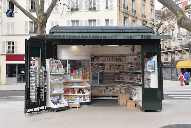 PARIS, FRANCE - MARCH 17:  A newspaper kiosk is seen while the city imposes emergency measures to combat the Coronavirus COVID-19 outbreak, on March 17, 2020 in Paris, France. The Coronavirus Covid-19 epidemic has exceeded 6,500 dead for more than 169,000 infections across the world. In order to combat the Coronavirus COVID-19 outbreak, and during a televised speech dedicated to the coronavirus crisis on March 16, French President, Emmanuel Macron announced that France starts a nationwide lockdown on March 17 at noon. (Photo by Stephane Cardinale - Corbis/Corbis via Getty Images)