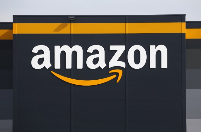 BRETIGNY-SUR-ORGE, FRANCE - APRIL 21: The logo of Amazon is seen on the facade of the company logistics center on April 21, 2020 in Bretigny-sur-Orge, France. The French government has ordered the American e-commerce giant Amazon to take measures at four of its sites in France to better protect employees against Covid-19. This Tuesday, the Versailles Court of Appeal examined the appeal filed by Amazon against a decision requiring it to restrict its activity in France during this period of confinement. Amazon Logistique France has finally decided to close all of its warehouses pending the decision of the Versailles Court of Appeal, which will be made on Friday April 24. The Coronavirus (COVID-19) pandemic has spread to many countries across the world, claiming over 171,000 lives and infecting over 2.5 million people. (Photo by Chesnot/Getty Images)