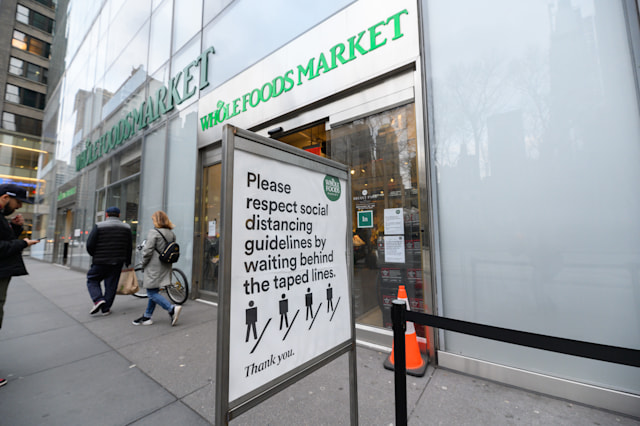 NEW YORK, NY - MARCH 31: A view outside Whole Foods Market during the Coronavirus pandemic on March 31, 2020 in New York City. President Trump has extended the social distancing guidelines to April 30. (Photo by Noam Galai/Getty Images)