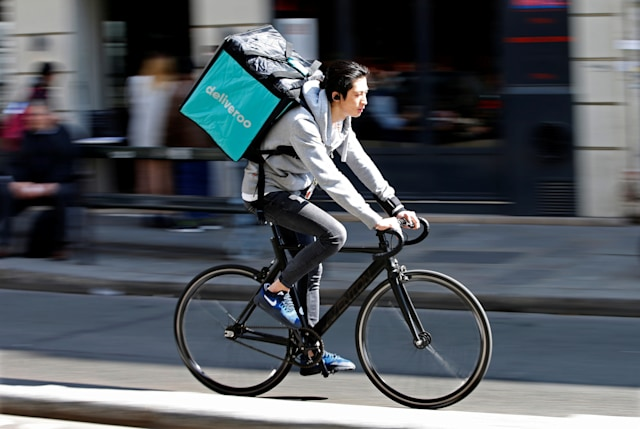 A cyclist rides a bicyle as he delivers food for Deliveroo, an example of the emergence of what is known as the 'gig economy', in Paris, France, April 7, 2017. Picture taken April 7, 2017. REUTERS/Charles Platiau
