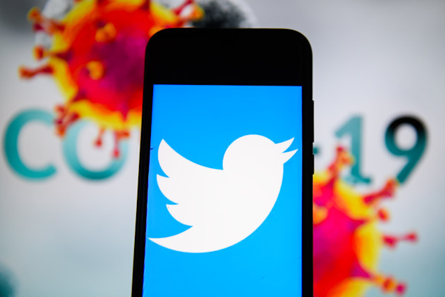POLAND - 2020/04/10: In this photo illustration a Twitter is seen displayed on a smartphone with a  COVID 19 sample on the background. (Photo Illustration by Omar Marques/SOPA Images/LightRocket via Getty Images)