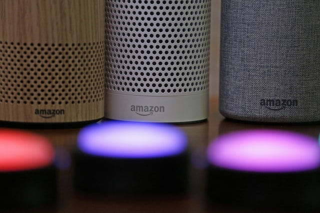 FILE - In this Sept. 27, 2017, file photo, Amazon Echo and Echo Plus devices, behind, sit near illuminated Echo Button devices during an event announcing several new Amazon products by the company in Seattle. Users of Amazon's Alexa digital assistant can now request that recordings of their voice commands delete automatically. (AP Photo/Elaine Thompson, File)