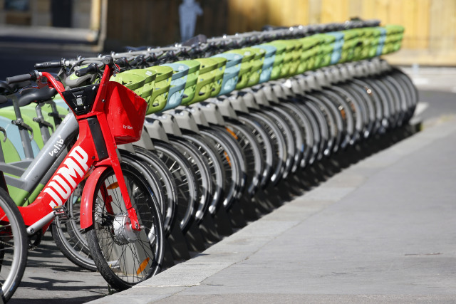 PARIS, FRANCE - MAY 14: An Uber Jump bike and Velib Metropole self-service public bikes are parked at a distribution point during the Coronavirus (COVID-19) pandemic on May 14, 2020 in Paris, France. Paris mayor Anne Hidalgo has launched a policy to promote the circulation of bikes in Paris. France is slowly reopening after almost two months of strict lockdown throughout the country due to the epidemic of coronavirus (COVID 19) on May 14, 2020 in Paris, France. The Coronavirus (COVID-19) pandemic has spread to many countries across the world, claiming over 300,000 lives and infecting over 4.4 million people. (Photo by Chesnot/Getty Images)
