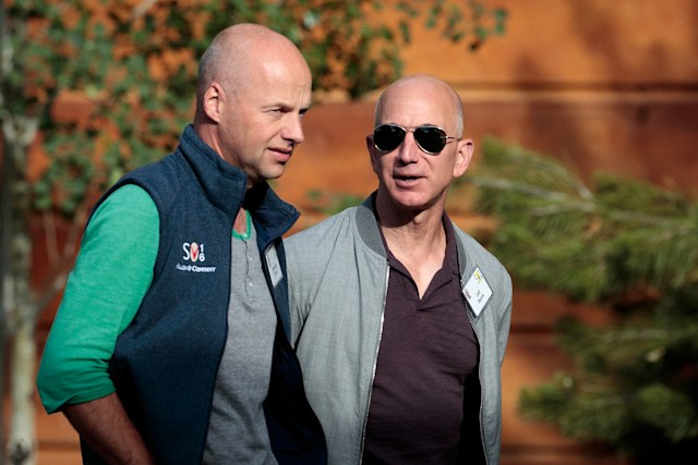 SUN VALLEY, ID - JULY 6: ( L to R) Sebastian Thrun, founder of Udacity and GoogleX, walks with Jeff Bezos, chief executive officer of Amazon.com Inc. and founder of Blue Origin, as they attend the annual Allen & Company Sun Valley Conference, July 6, 2016 in Sun Valley, Idaho. Every July, some of the world's most wealthy and powerful businesspeople from the media, finance, technology and political spheres converge at the Sun Valley Resort for the exclusive weeklong conference. (Photo by Drew Angerer/Getty Images)