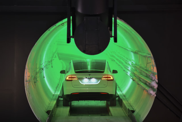 HAWTHORNE, CA - DECEMBER 18: A modified Tesla Model X electric vehicle enters a tunnel before an unveiling event for The Boring Company Hawthorne test tunnel December 18, 2018 in Hawthorne, California. On Tuesday night, The Boring Company will officially open the Hawthorne tunnel, a preview of Musk's larger vision to ease traffic in Los Angeles. (Photo by Robyn Beck-Pool/Getty Images)