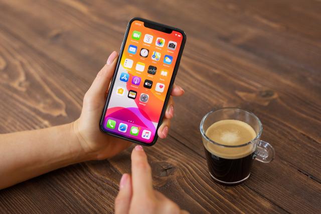 Riga, Latvia - December 3, 2019: Person using Apple iPhone 11 Pro.