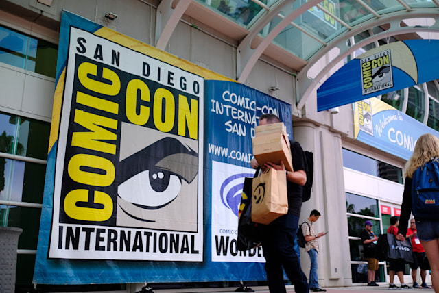People walk in front of the Convention Center during Comic Con in San Diego, California on July 17, 2019. (Photo by Chris Delmas / AFP)        (Photo credit should read CHRIS DELMAS/AFP via Getty Images)