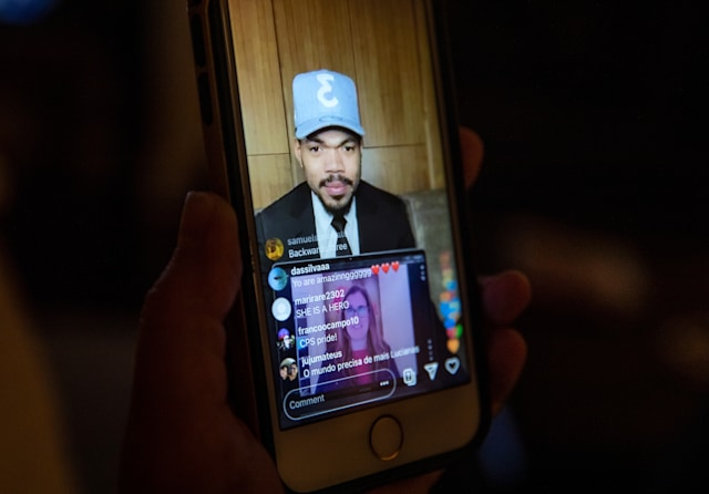 STAMFORD, CONNECTICUT - MAY 7: Chance the Rapper and elementary school teacher Luciana Lira, 42, speak via Instagram Live during the artist's Twilight Awards event honoring teachers on May 7, 2020 in Stamford, Connecticut. He announced Lira would receive $15,000 for herself, $15,000 for her school and a computer and a year of internet for the immigrant family that Lira is helping. Lira, a K-5 Bilingual /ESL teacher at Hart Magnet Elementary in Stamford, became the temporary guardian of newborn baby Neysel after the boy's mother Zully, almost 8 months pregnant, went to the Stamford Hospital emergency room, gravely ill with COVID-19 and gave birth. Hospital staff put Zully on a ventilator and performed an emergency C-section to save the child. Neysel could not go home, as his father Marvin and brother Junior were COVID-19 positive and quarantined there. After several weeks in the hospital ICU Zully responded well to antibody blood plasma transfusions and was able to return home. The teacher Lira will continue caring for the baby until the infant's parents and brother test COVID-negative, and the Guatemalan immigrant family can be reunited. Chance the Rapper is giving a total of $300,000 to teachers and their schools during this year's inaugural event. (Photo by John Moore/Getty Images)
