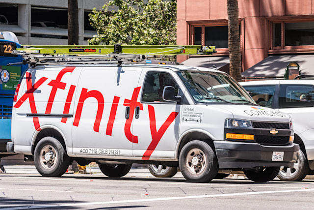 May 20, 2020 San Jose / CA / USA - Side view of Comcast Cable / Xfinity service van driving on the street. Comcast is the largest home internet service provider in the United States.