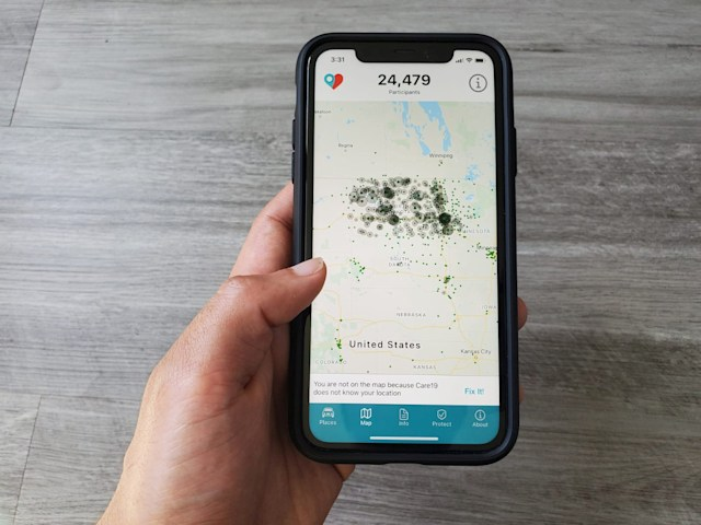 The Care19 mobile app, which the governors of North Dakota and South Dakota have asked residents to download to assist in contact tracing during the global outbreak of the coronavirus disease (COVID-19), is seen on a phone, U.S. April 24, 2020. REUTERS/Paresh Dave