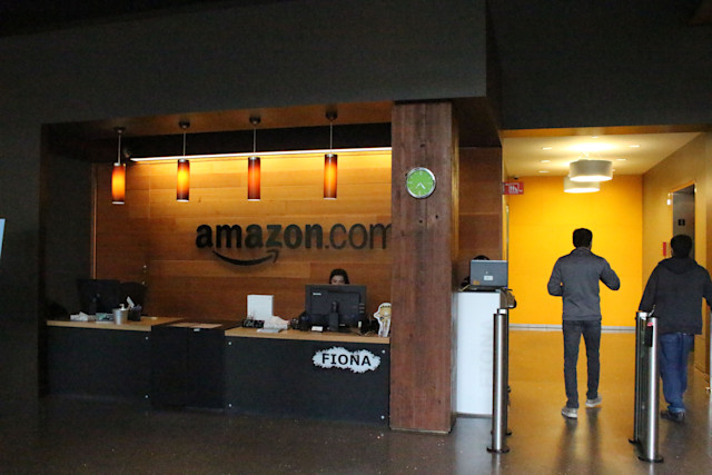 Nikol Szymul staffs a reception desk at Amazon offices discretely tucked into a building called Fiona in downtown Seattle, Washington on May 11, 2017.  Online retail powerhouse Amazon is constructing an eye-catching Spheres office building to feature waterfalls, tropical gardens and other links to nature as part of its urban campus in Seattle, Washington.  / AFP PHOTO / Glenn CHAPMAN        (Photo credit should read GLENN CHAPMAN/AFP via Getty Images)