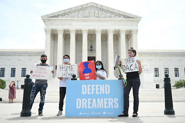 Deferred Action for Childhood Arrivals (DACA) demonstrators stand outside the US Supreme Court in Washington, DC, on June 15, 2020. (Photo by JIM WATSON / AFP) (Photo by JIM WATSON/AFP via Getty Images)