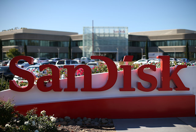 MILPITAS, CA - OCTOBER 21:  A sign is posted in front of the SanDisk headquarters on October 21, 2015 in Milpitas, California. Computer data storage company Western Digital announced plans to acquire flash memory storage maker SanDisk for $19 billion.  (Photo by Justin Sullivan/Getty Images)