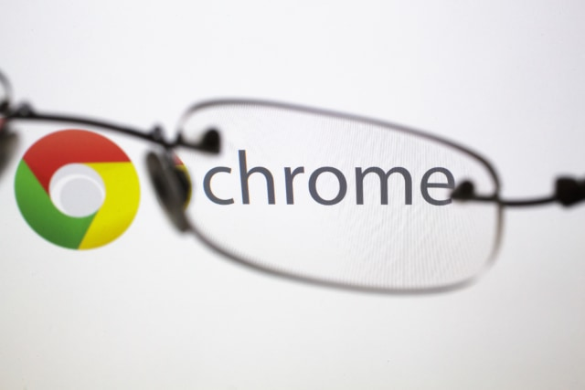 BERLIN, GERMANY - SEPTEMBER 03: Posed scene on the topic google chrome, glasses in front of the google chrome company logo on September 03, 2015 in Berlin, Germany. Photo by Thomas Trutschel/Photothek via Getty Images)
