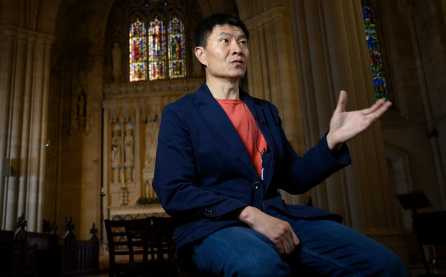 Fengsuo Zhou, President of Humanitarian China, answers questions during an interview May 7, 2019 at the Cathedral of St. John the Divine in New York. (Photo by Don Emmert / AFP)        (Photo credit should read DON EMMERT/AFP via Getty Images)