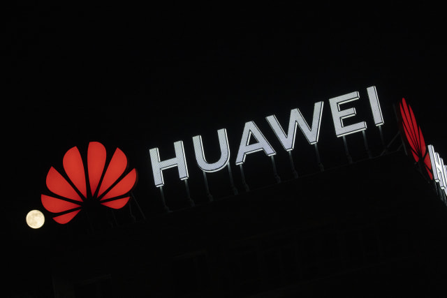 "The Huawei logo is seen atop a buildin in central Warsaw, Poland on April 8, 2020. Chinese Huawei is the largest telecommunications company in the world and the second largest mobile phone manufacturer in the world after Samsung. In January 2019 a Huawei employee in Poland had been arrested on charges of espionage at the local offices of the company in Warsaw. Huawei says it has won a quarter of all 5G contracts all around the world despite worries of security leaks involving ""backdoors"". (Photo by Jaap Arriens/NurPhoto via Getty Images)"