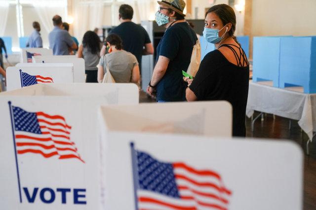ATLANTA, GA - JUNE 09: People wait in line to vote in Georgia's Primary Election on June 9, 2020 in Atlanta, Georgia. Voters in Georgia, West Virginia, South Carolina, North Dakota, and Nevada are holding primaries amid the coronavirus pandemic. (Photo by  Elijah Nouvelage/Getty Images)