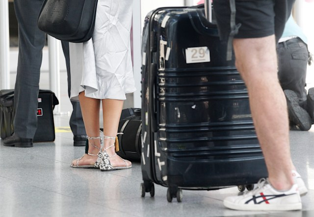 26 June 2020, North Rhine-Westphalia, Duesseldorf: Passengers wait at Düsseldorf Airport for their check-in. In North Rhine-Westphalia, the school holidays begin on Friday. Photo: Roland Weihrauch/dpa (Photo by Roland Weihrauch/picture alliance via Getty Images)