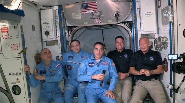INTERNATIONAL SPACE STATION - MAY 31: In this screen grab from NASA's feed, NASA astronauts Doug Hurley (R) and Bob Behnken (2R) join NASA astronaut Chris Cassidy (C) and Russian cosmonauts, Anatoly Ivanishin (L) and Ivan Vagner (2L) aboard the International Space Station after successfully docking SpaceX's Dragon capsule May 31, 2020. The docking occurred just 19 hours after a SpaceX Falcon 9 rocket blasted off Saturday afternoon from Kennedy Space Center, the nation's first astronaut launch to orbit from home soil in nearly a decade. (Photo by NASA via Getty Images)