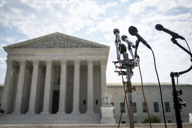 WASHINGTON, DC - JULY 06:  A set of microphones stand outside of the U.S. Supreme Court on July 6, 2020 in Washington, DC. The Supreme Court issued a unanimous opinion on Monday that says states can require Electoral College voters to back the winner of their states popular vote in a presidential election. The court also upheld a 1991 law that bars robocalls to cellphones. (Photo by Drew Angerer/Getty Images)
