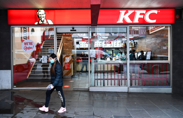 A person walks past a KFC outlet in Melbourne's central business district on July 15, 2020. - Australians under lockdown for the second time are struggling with fresh virus restrictions, with police saying on July 15 they had dished out hundreds of fines including to people playing Pokemon Go and eating KFC. (Photo by William WEST / AFP) (Photo by WILLIAM WEST/AFP via Getty Images)