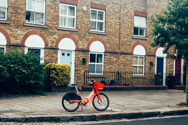 London/UK - 17/07/2019: Dockless Jump electric bike locked and left on a sidewalk of a street in Camden. Jump is an electric bicycle sharing system operating in the United Kingdom, owned by Uber