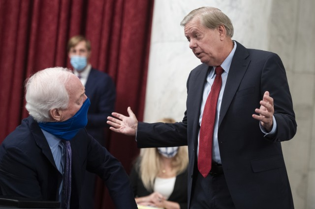 UNITED STATES - JULY 2: Chairman Lindsey Graham, R-S.C., right, and Sen. John Cornyn, R-Texas, talk before the start of the Senate Judiciary Committee markup of the Eliminating Abusive and Rampant Neglect of Interactive Technologies (EARN IT) Act of 2020, and judicial nominations in Russell Building on Thursday, July 2, 2020.(Photo By Tom Williams/CQ-Roll Call, Inc via Getty Images)