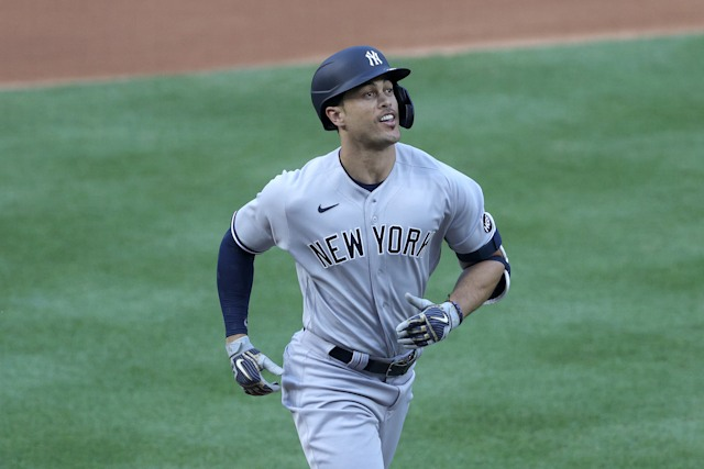 WASHINGTON, DC - JULY 23: Giancarlo Stanton #27 of the New York Yankees rounds the bases after hitting a two run home run to center field against Max Scherzer #31 of the Washington Nationals during the first inning in the game at Nationals Park on July 23, 2020 in Washington, DC. (Photo by Rob Carr/Getty Images)
