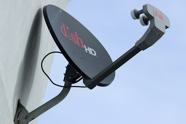 A Dish Network satellite dish is shown on a residential home in Encinitas, California, U.S., November 8, 2017. REUTERS/Mike Blake