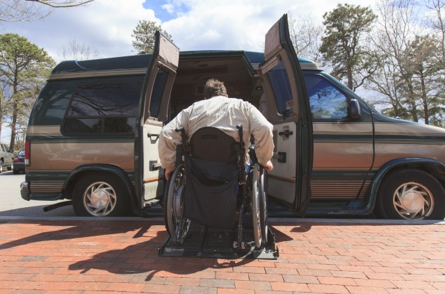 Man with Spinal Cord Injury entering his accessible van