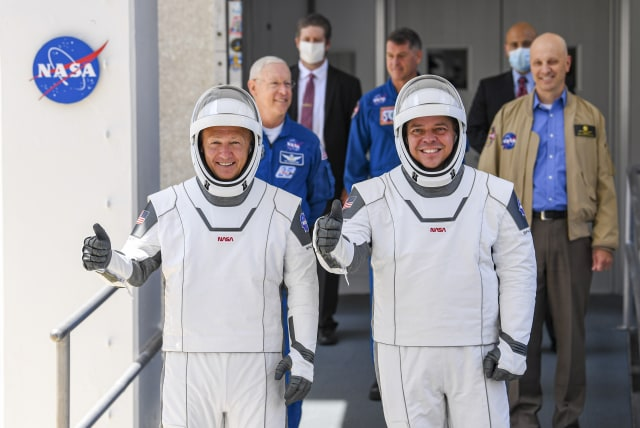 KENNEDY SPACE CENTER, FL - MAY 30:  NASA commercial crew astronauts Doug Hurley (L) and Bob Behnken walk out on their way to launch from historic Launch Complex 39A aboard the SpaceX Falcon 9 rocket in the crew Dragon capsule bound for the International Space Station.  (Photo by Jonathan Newton/The Washington Post via Getty Images)
