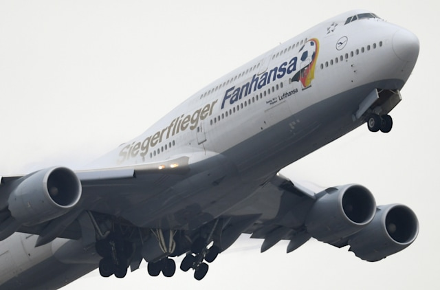 "A Lufthansa Boeing 747-8 with the additional name ""Lufthansa Siegerflieger"" (lit. ""Lufthansa Victor's plane"") takes off at the airport in Frankfurt am Main, Germany, 4 December 2017. Photo: Arne Dedert/dpa (Photo by Arne Dedert/picture alliance via Getty Images)"