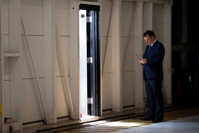US Senator Ted Cruz, R-Texas, checks his cell phone as he awaits the arrival of US President Donald Trump at Ellington Field Joint Reserve Base in Houston, Texas on May 31, 2018. (Photo by JIM WATSON / AFP)        (Photo credit should read JIM WATSON/AFP via Getty Images)