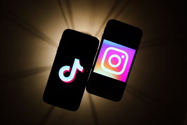 TikTok and Instagram logos are seen displayed on a phone screens in this illustration photo taken in Krakow, Poland on November 14, 2019.  (Photo by Jakub Porzycki/NurPhoto via Getty Images)