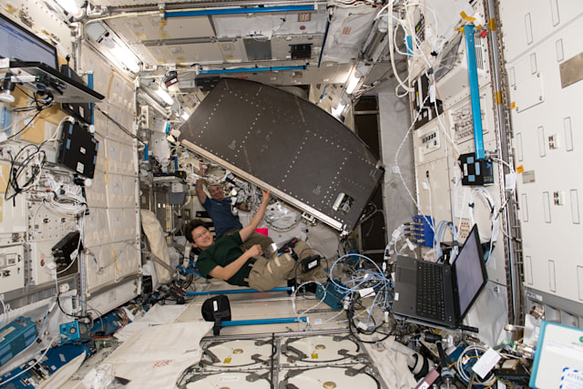 Astronauts move NASA's EXPRESS Rack 4 on the ISS