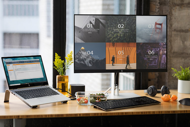 HP E27q G4 monitor paired with a laptop