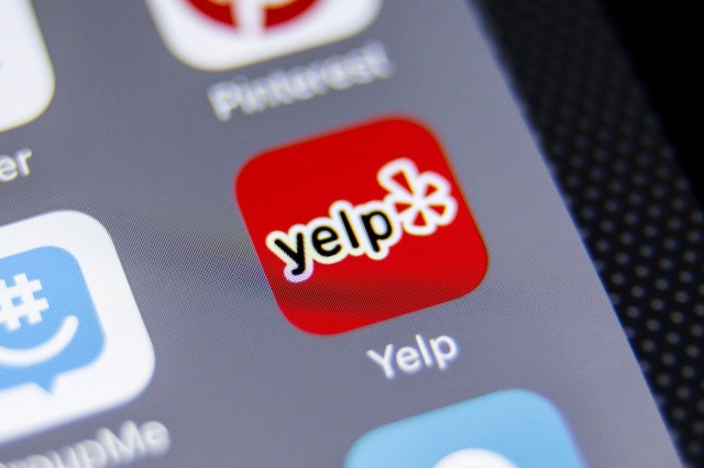 A picture of the Yelp app on a smart phone.