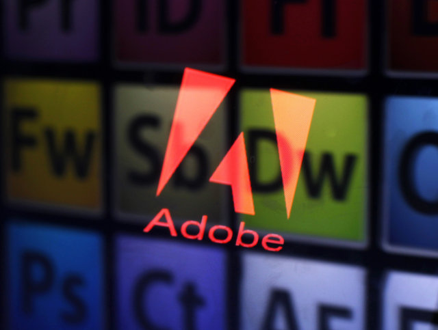 An Adobe logo and Adobe products are seen reflected on a monitor display and an iPad screen, in this picture illustration taken in the central Bosnian town of Zenica July 8, 2013. Picture taken July 8, 2013. To match Special Report TAX-BIGTECH/   REUTERS/Dado Ruvic (BOSNIA AND HERZEGOVINA - Tags: BUSINESS SCIENCE TECHNOLOGY TPX IMAGES OF THE DAY LOGO)