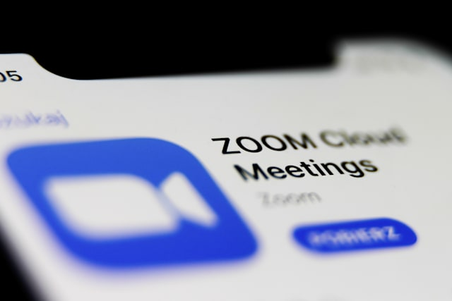 Zoom app logo is seen displayed on phone screen in this illustration photo taken in Poland on July 23, 2020. Video meeting apps gained popularity during the coronavirus pandemic.  (Photo illustration by Jakub Porzycki/NurPhoto via Getty Images)