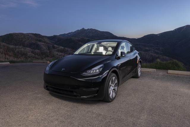 A black 2020 Tesla Model Y car in the mountains of Utah after dusk with interesting interior/exterior lighting technique to show off the general awesomeness of this particular electric vehicle. Taken June 26, 2020 near Payson, Utah, USA.