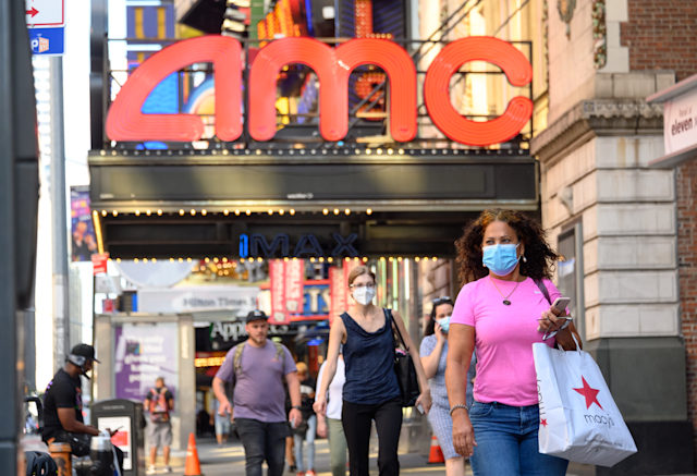 NEW YORK, NEW YORK - AUGUST 05: People wear protective face masks outside the AMC Empire 25 movie theater in Times Square as the city continues Phase 4 of re-opening following restrictions imposed to slow the spread of coronavirus on August 5, 2020 in New York City. The fourth phase allows outdoor arts and entertainment, sporting events without fans and media production. (Photo by Noam Galai/Getty Images)