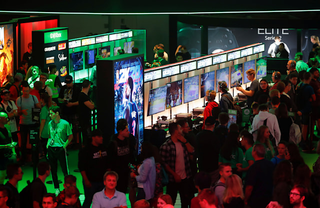 Gamers play Xbox video games at the booth of Microsoft on the first day of Europe's leading digital games fair Gamescom, which showcases the latest trends of the computer gaming scene in Cologne, Germany, August 21, 2019. REUTERS/Wolfgang Rattay