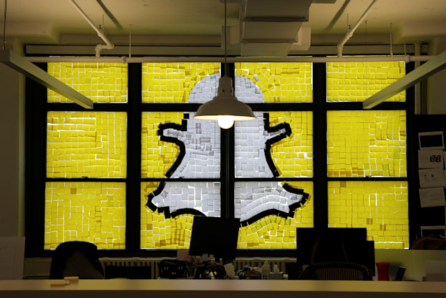 """An image of the Snapchat logo created with Post-it notes is seen in the windows of Havas Worldwide at 200 Hudson Street in lower Manhattan, New York, U.S., May 18, 2016, where advertising agencies and other companies have started what is being called a """"Post-it note war"""" with employees creating colorful images in their windows with Post-it notes. REUTERS/Mike Segar     TPX IMAGES OF THE DAY"""