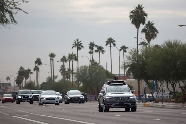 A self driving Volvo vehicle, purchased by Uber, moves along the streets of Scottsdale, Arizona, U.S., December 1, 2017.  Photo taken on December 1, 2017.  REUTERS/Natalie Behring