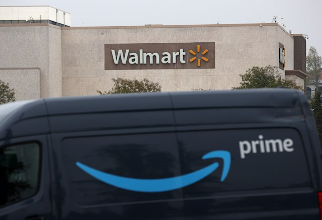 RICHMOND, CALIFORNIA - SEPTEMBER 03: An Amazon Prime delivery van sits parked near a Walmart store on September 03, 2020 in Richmond, California. Walmart has announced plans to launch Walmart Plus delivery service to compete with Amazon Prime. The $98 per year service will offer free delivery of food and items available from nearby stores. (Photo by Justin Sullivan/Getty Images)