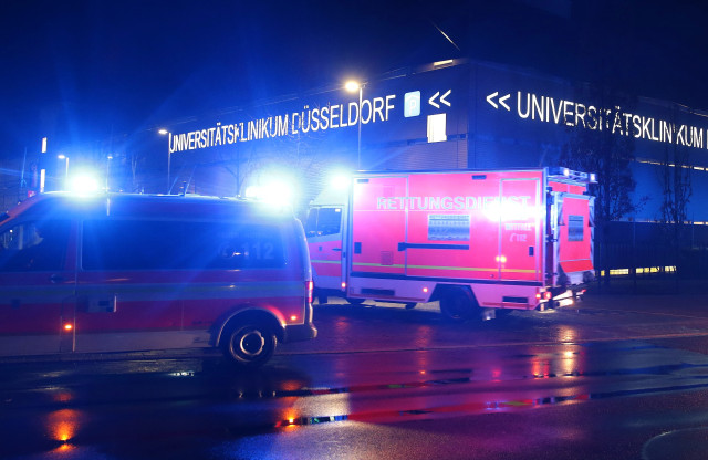 26 February 2020, North Rhine-Westphalia, Duesseldorf: Ambulances drive to the grounds of the University Hospital in the early morning. After infection with the novel coronavirus, a man was transferred from a hospital in Erkelenz to Düsseldorf. Photo: David Young/dpa (Photo by David Young/picture alliance via Getty Images)